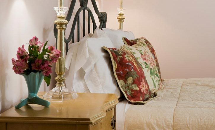 Queen iron bed in our Ultimate Romantic Getaway in New England