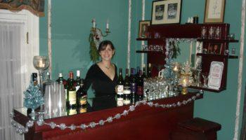 Girl bartending at Hampton Terrace