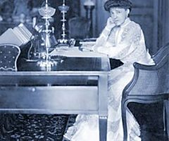 Old photo of a woman sitting at a desk