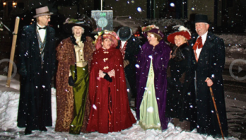 Christmas carolers in the snow