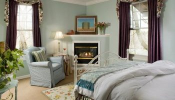 Sunol Room bed, chair, and fireplace