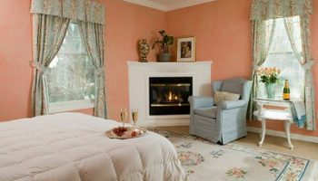 Peerless Room bed, chair, and fireplace