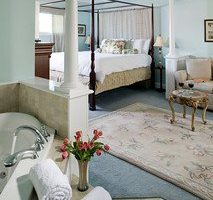 Pearl Davis Suite bed, seating, and spa tub