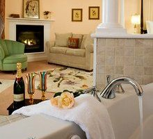 Rosalyn Elkan Suite spa tub, seating area, and fireplace
