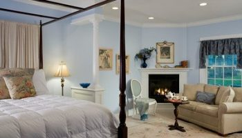 Marion Slocomb Suite bed, seating area and fireplace