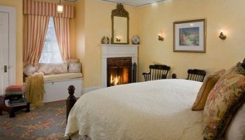 The Bonner Room bed, seating and fireplace