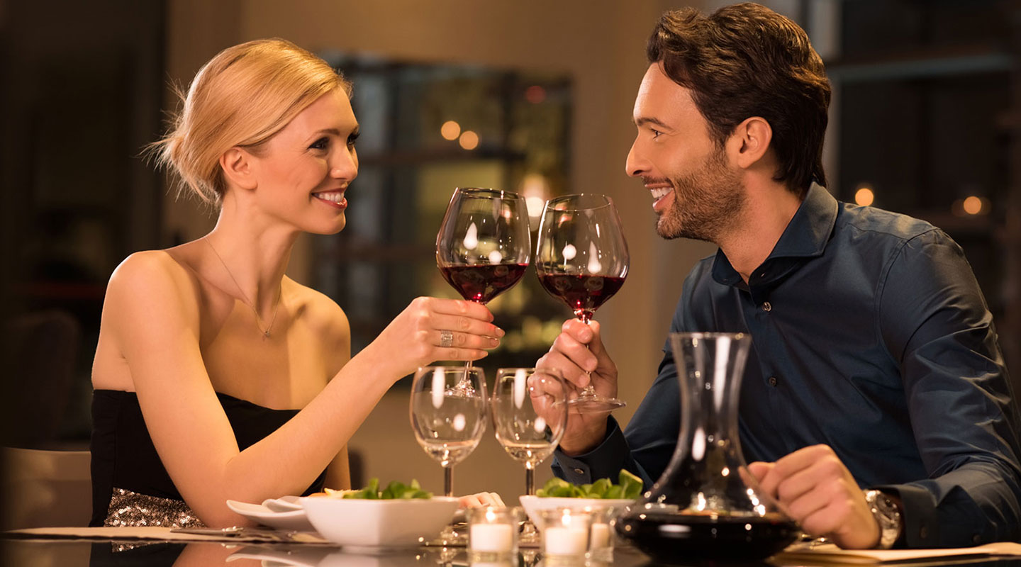 Couple Have a Romantic Dinner with Red Wine