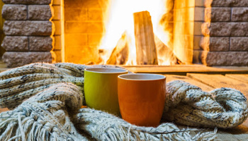 Two mugs by the fire on winter getaway in MA