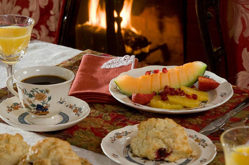 Fruit, tea, and baked goods for breakfast at our Lenox, MA inn