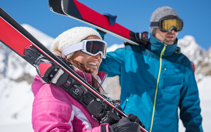 Couple skiing for their Lenox Winter Getaway