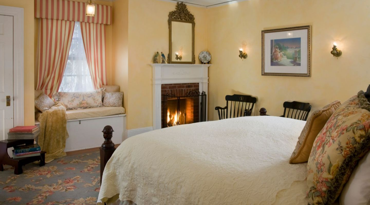 Quaint room with yellow walls and fireplace