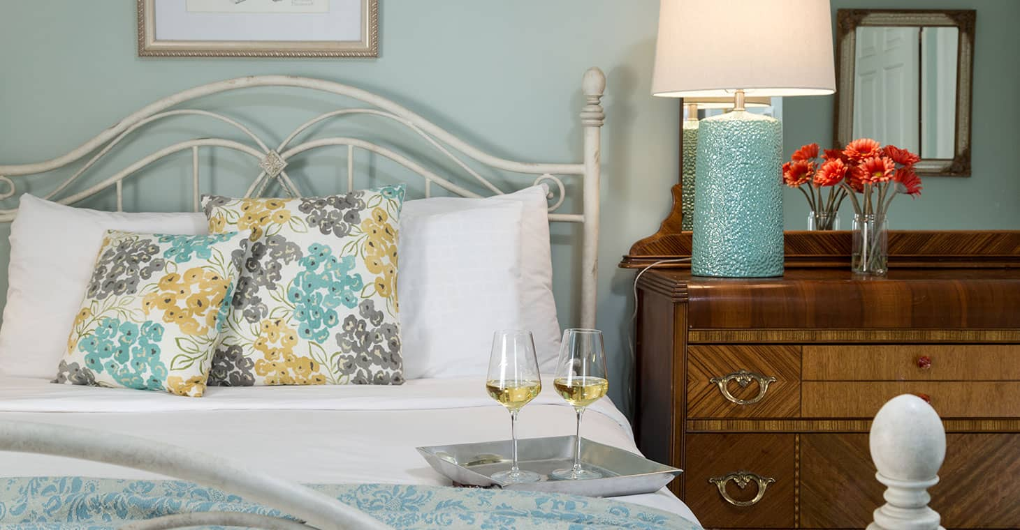 Sunol guest room with blues and yellows