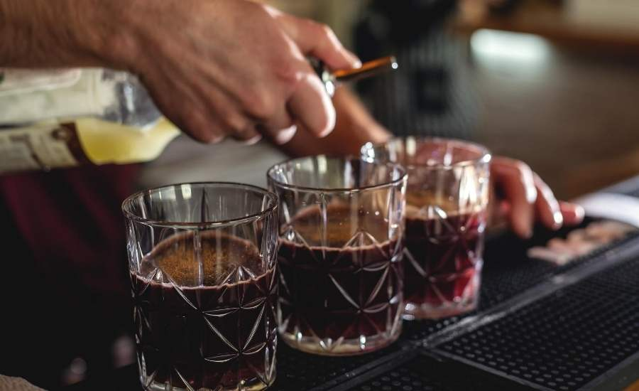 Bartender Pouring Mezcal Mules in Glasses