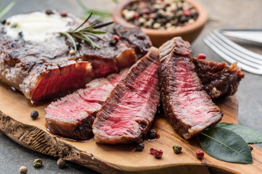 steak displayed on a cutting board