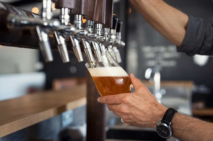 A bartender pouring a beer